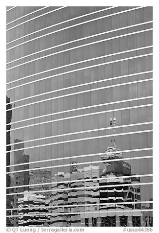 Federal building reflected in glass facade. Oakland, California, USA (black and white)