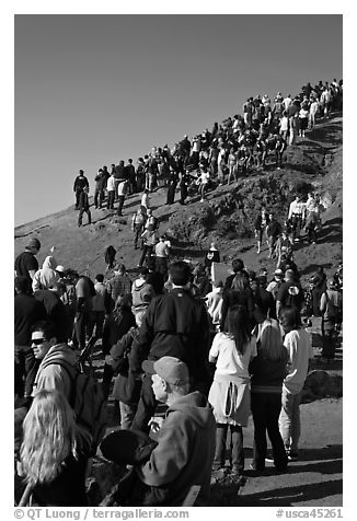 Spectators on bluff during mavericks contest. Half Moon Bay, California, USA (black and white)