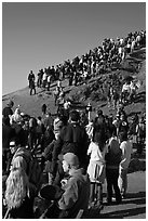 Spectators on bluff during mavericks contest. Half Moon Bay, California, USA ( black and white)