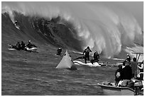 Surfer on big surf and observers. Half Moon Bay, California, USA (black and white)