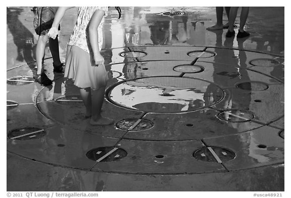 Reflections of children playing in fountain, Gilroy Gardens. California, USA (black and white)
