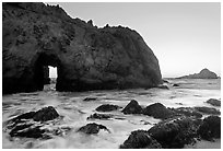 Pfeiffer Beach arch at sunset. Big Sur, California, USA (black and white)