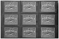 Boxes of canned sardines, Monterey Bay Aquarium. Monterey, California, USA (black and white)