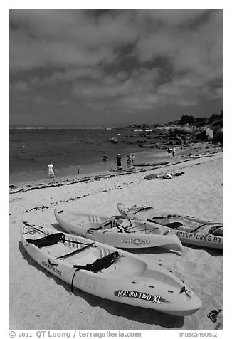 Sea kayaks on beach, Lovers Point. Pacific Grove, California, USA (black and white)