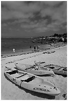 Sea kayaks on beach, Lovers Point. Pacific Grove, California, USA ( black and white)