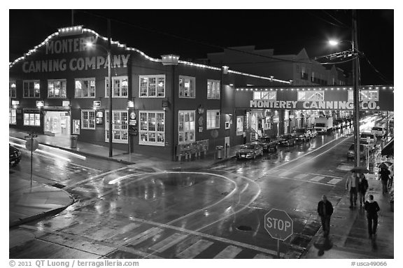 Monterey Canning company building and streets at night. Monterey, California, USA (black and white)