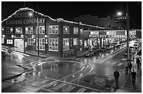 Monterey Canning company building and streets at night. Monterey, California, USA ( black and white)