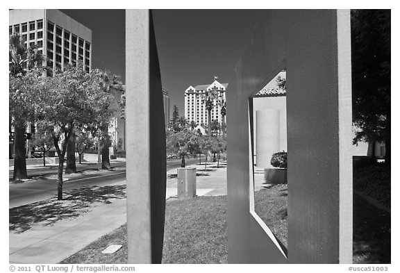 Downtown San Jose seen through colorful modern sculpture. San Jose, California, USA (black and white)