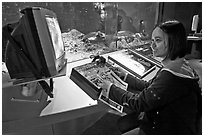 Woman controls robot, Tech Museum. San Jose, California, USA (black and white)