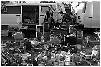 Vans and household items for sale, San Jose Flee Market. San Jose, California, USA ( black and white)