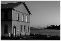 Tiburon Road-Ferry museum and Golden Gate Bridge at sunset. California, USA (black and white)