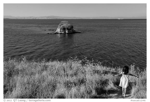 Girl on San Pablo Bay grassy shore, China Camp State Park. San Pablo Bay, California, USA (black and white)