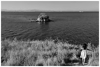 Girl on San Pablo Bay grassy shore, China Camp State Park. San Pablo Bay, California, USA ( black and white)