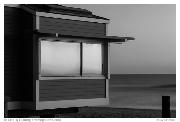 Sunset reflected in beach house window, Stinson Beach. California, USA (black and white)