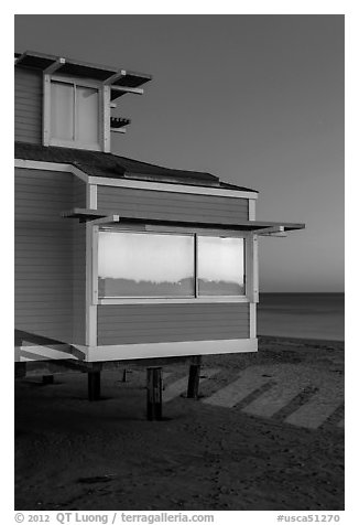 Contemporary beach house at dusk, sunset reflection, Stinson Beach. California, USA (black and white)