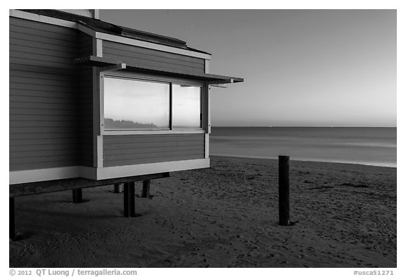 Modern beach house with large window reflecting sunset, Stinson Beach. California, USA (black and white)