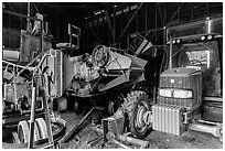 Barn full of agricultural machinery, Ardenwood farm, Fremont. California, USA (black and white)