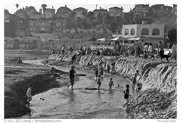 Children playing in tidal stream. Capitola, California, USA (black and white)