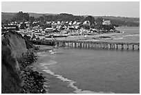 Cliff, Fishing Pier at sunset, and village. Capitola, California, USA (black and white)