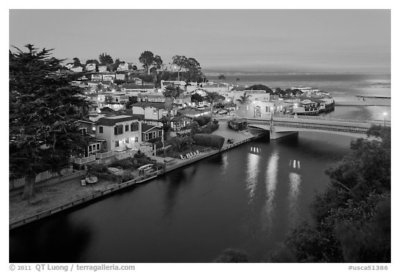 Bridges over Soquel Creek and village at dusk. Capitola, California, USA (black and white)