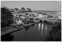 Bridges over Soquel Creek and village at dusk. Capitola, California, USA ( black and white)