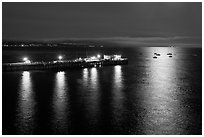 Pier and yachts with moon reflection. Capitola, California, USA ( black and white)