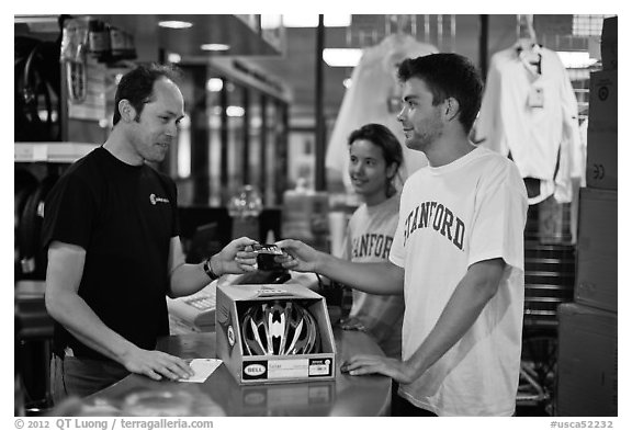 Students paying at register with credit card, Campus Bike Shop. Stanford University, California, USA (black and white)