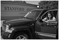 Student with new car. Stanford University, California, USA ( black and white)