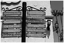 Signs pointing to local businesses, Avalon Bay, Catalina. California, USA ( black and white)