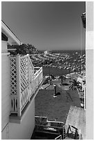 Harbor seen from between hillside houses, Avalon, Catalina. California, USA (black and white)