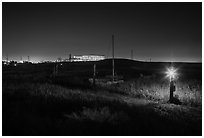 Marsh by night with office building in distance, Alviso. San Jose, California, USA ( black and white)