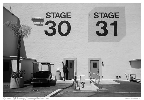 Man entering soundstage, Paramount Pictures Studios lot. Hollywood, Los Angeles, California, USA (black and white)