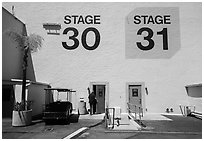 Man entering soundstage, Paramount Pictures Studios lot. Hollywood, Los Angeles, California, USA ( black and white)