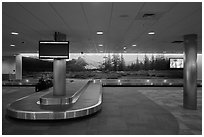 Baggage claim area and Tuolumne Meadows mural, Fresno Yosemite Airport. California, USA ( black and white)