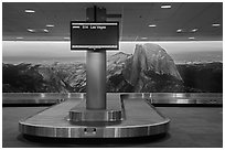 Baggage claim area and Half-Dome mural, Fresno Yosemite Airport. California, USA ( black and white)