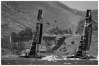 Emirates Team New Zealand leeward of Oracle Team USA at first mark. San Francisco, California, USA ( black and white)
