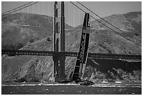 Oracle Team USA defender America's cup boat and Golden Gate Bridge. San Francisco, California, USA ( black and white)