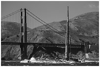 Oracle Team USA AC72 America's cup boat and Golden Gate Bridge. San Francisco, California, USA ( black and white)