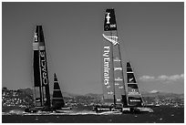 New Zealand boat leading USA boat on first downwind leg of decisive race. San Francisco, California, USA ( black and white)
