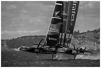 Emirates Team New Zealand Aotearoa catamaran foiling in upwind leg. San Francisco, California, USA ( black and white)