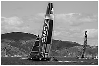 USA boat leading New Zealand boat during upwind leg of America's cup final race. San Francisco, California, USA (black and white)