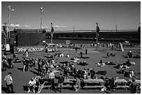 Synthetic lawn and giant screen, America's Cup Park. San Francisco, California, USA ( black and white)
