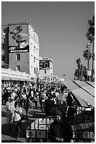 Crowded Ocean Front Walk in summer. Venice, Los Angeles, California, USA ( black and white)