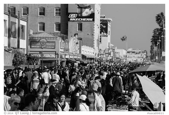 Ocean Front Walk with throngs of people. Venice, Los Angeles, California, USA (black and white)