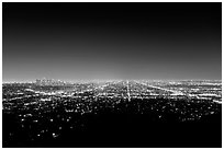 Lights of street grid and downtown at night from Griffith Park. Los Angeles, California, USA ( black and white)
