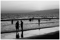 Sunset with beachgoers in water. Santa Monica, Los Angeles, California, USA ( black and white)