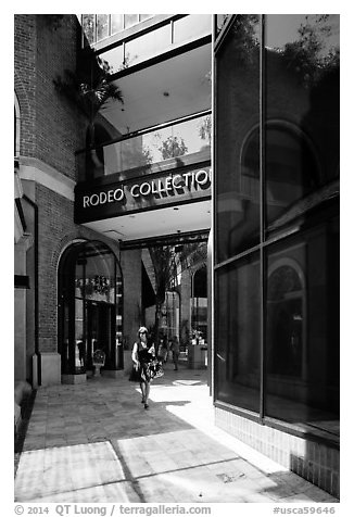 Woman walks in Rodeo Collection shopping area. Beverly Hills, Los Angeles, California, USA (black and white)