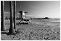 Lifeguard tower, empty beach, and Newport Pier. Newport Beach, Orange County, California, USA ( black and white)