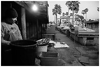 Fisherman, beachside fishing cooperative. Newport Beach, Orange County, California, USA ( black and white)