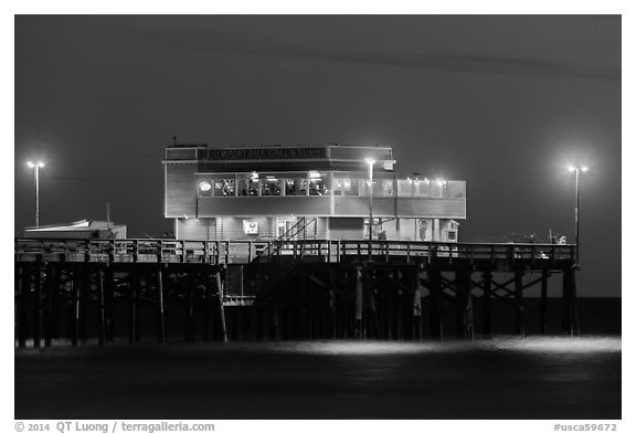 Newport Pier and restaurant at night. Newport Beach, Orange County, California, USA (black and white)